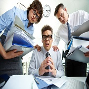 "MIT informatika: Ali res potrebujete dokumentni sistem (Foto: ""Designed by Pressfoto / Freepik"") Pleading accountant looking at camera being surrounded by his partners with huge piles of documents"